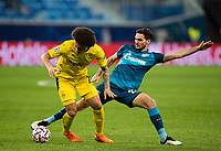 SAINT PETERSBURG, RUSSIA - DECEMBER 08: Magomed Ozdoev of Zenit St. Petersburg tries to dispossess Axel Witsel of Borussia Dortmund during the UEFA Champions League Group F stage match between Zenit St. Petersburg and Borussia Dortmund at Gazprom Arena on December 8, 2020 in Saint Petersburg, Russia. (Photo by MB Media)