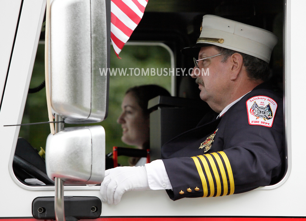 Salisbury Mills, New York -A member of the Salisbury Mills Fire Department drives a fire truck down Route 94 during the Orange County Volunteer Firemen's Association (OCVFA) annual parade on Sept. 24, 2011.