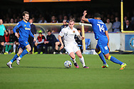 AFC Wimbledon midfielder Tom Soares (14) closing down Northampton Town midfielder Gregg Wylde (11) during the EFL Sky Bet League 1 match between AFC Wimbledon and Northampton Town at the Cherry Red Records Stadium, Kingston, England on 11 March 2017. Photo by Matthew Redman.