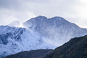 Spindrift blows across Lliwedd, one arm of the Snowdon horseshoe, Snowdonia, Wales