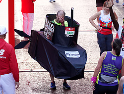 Runners after finishing the Virgin Money London Marathon. Picture date: Sunday October 3, 2021.