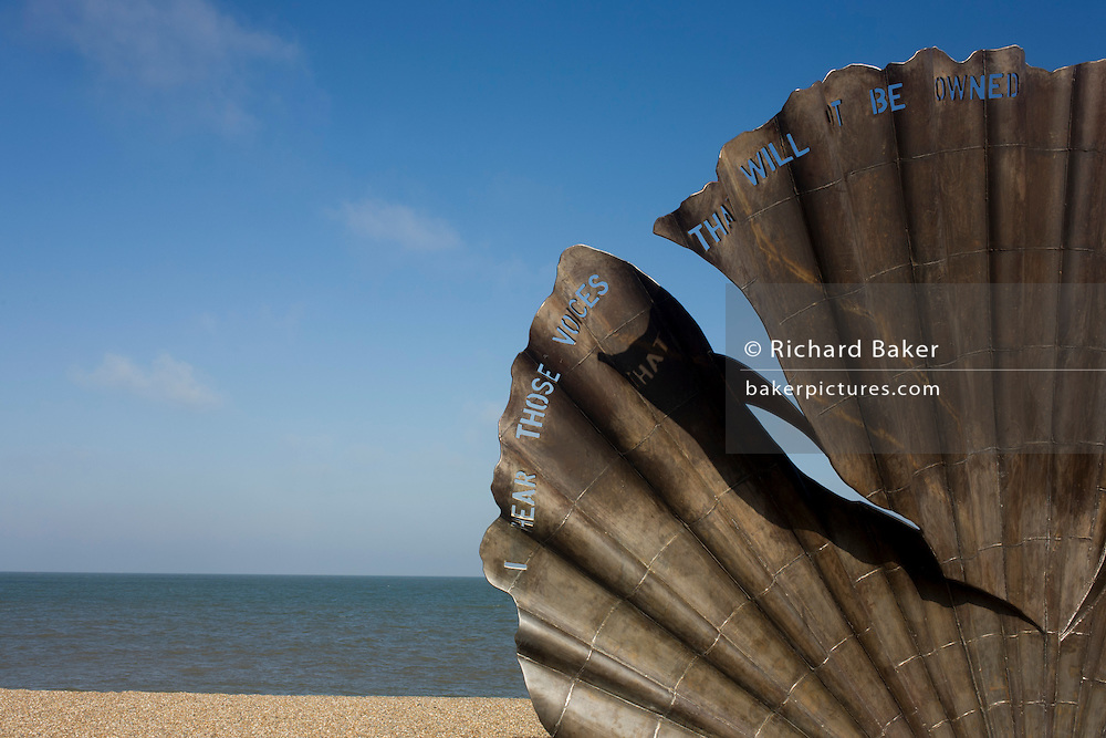 "Scallop, a 4 metre high steel sculpture of two interlocking scallop shells on Aldeburgh beach dedicated to Benjamin Britten. Hambling's Scallop (2003) stands on the north end of Aldeburgh beach. It is a tribute to Benjamin Britten and is pierced with the words ""I hear those voices that will not be drowned"" from his opera Peter Grimes."