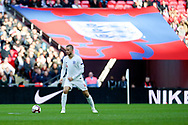 England's Eric Dier dribbling with bug England flag in the background during the UEFA Nations League match between England and Croatia at Wembley Stadium, London, England on 18 November 2018.