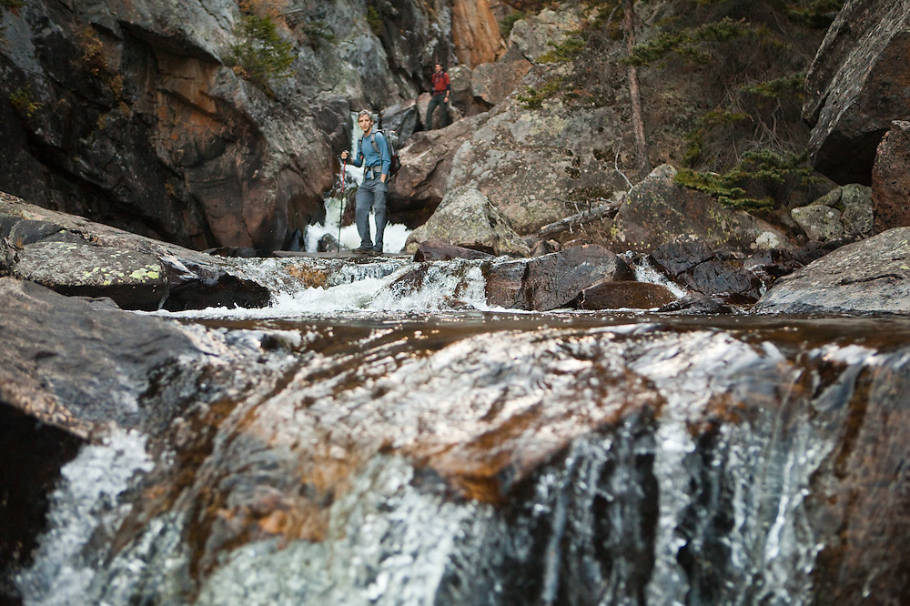 David Coffey and Obadiah Reid stand by a waterfall on a hike down Big Thompson River, Rocky Mountain National Park, Colorado.