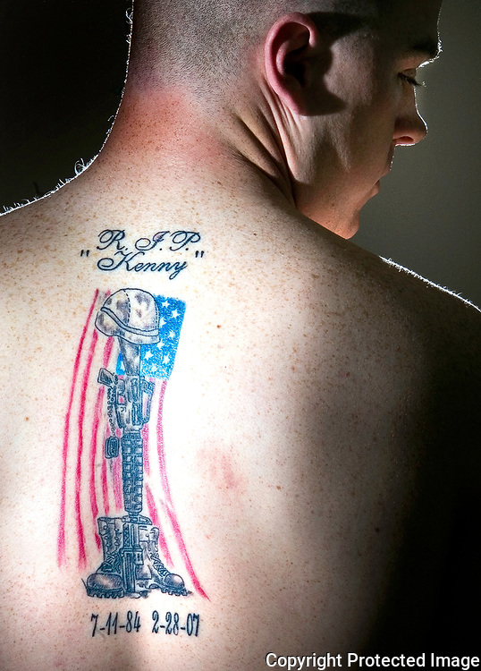 A soldier commemorates his his cousin with a fresh tattoo. His cousin died while in combat in Iraq.
