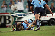 Warathas number eight Wycliff Palu dives over to score a try. Super 14 Rugby Union, Waratahs v Lions, Sydney Football Stadium, Australia. Friday 12 March 2010. Photo: Clay Cross/PHOTOSPORT