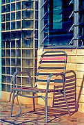 """A beat-up lawn chair at a retirement home in an old Art Deco, Miami Beach hotel in 1996, when many senior citizens still lived in South Beach. <br /> <br /> Since then, artists and hip entrpreneurs and, later, mainstream tourists and well-to-do condo-dwellers took over the neighborhood, which is quite posh now and is no longer thought of as """"God's Waiting Room."""""""
