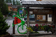 Green bike advertises a local hotel in the Dolomites near La Villa, in Alta Badia, south Tyrol, Italy. With just half a million inhabitants, south Tyrol attracts nearly 6m holidaymakers annually who total 29m overnight stays a year. The Dolomites are a mountain range in northeastern Italy and in August 2009, the Dolomites were declared a UNESCO World Heritage Site.