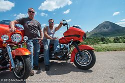 Stopped along highway 79 near Sturgis with Bear Butte in the background during the 75th Annual Sturgis Black Hills Motorcycle Rally.  SD, USA.  August 6, 2015.  Photography ©2015 Michael Lichter.