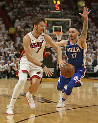 April 19, 2018 - Miami, FL, USA - The Miami Heat's Goran Dragic, left, passes against the Philadelphia 76ers' JJ Redick during the first quarter in Game 3 of a first-round NBA playoff series at AmericanAirlines Arena in Miami on Thursday, April 19, 2018. (Credit Image: © David Santiago/TNS via ZUMA Wire)