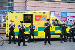 © Licensed to London News Pictures; 16/04/2020; Bristol, UK. Members of the emergency services and the public clap at 8pm on Thursday evening outside the Bristol Royal Infirmary hospital to applaud NHS health service workers during the coronavirus Covid-19 pandemic. Today the UK recorded another 861 coronavirus deaths in hospital, taking the total to 13,729, with a total of 103,093 people who have tested positive for the virus. There is a UK wide lockdown with the biggest restrictions on freedom of movement ever imposed in the UK. Photo credit: Simon Chapman/LNP.