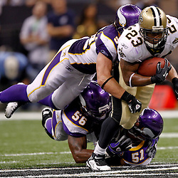 September 9, 2010; New Orleans, LA, USA;  New Orleans Saints running back Pierre Thomas (23) breaks tackles by Minnesota Vikings linebacker E.J. Henderson (56) and linebacker Ben Leber (51) and linebacker Chad Greenway (52) in the fourth quarter to get a first down securing a 14-9 win during the NFL Kickoff season opener at the Louisiana Superdome.   Mandatory Credit: Derick E. Hingle