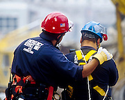 """NEW YORK, NY: Recovery workers comfort each other at """"Ground Zero"""" of the World Trade Center complex after the WTC terrorist attack, Sept. 22, 2001.  Almost 3,000 people were killed when terrorists crashed hijacked passenger jets into the twin towers. PHOTO BY JACK KURTZ"""