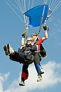 Summer getting ready to land after taking her first skydive with instructor Mark from Australia.