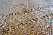 Woven coconut mat in a Fijian bure.
