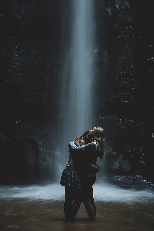 Buraco Do Padre, Brazil - March 23, 2019: A mother and daughter embrace near a waterfall at Buraco Do Padre near Ponta Grossa in Brazil's Parana state.