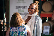 """Chef Nyanyika Banda shares a laugh with host Lindsay Christians before the """"Corner Table Podcast"""" recording at Old Sugar Distillery in Madison, Wisconsin, Tuesday, June 18, 2019."""