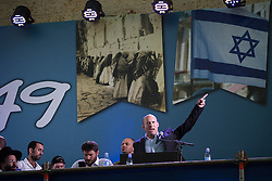 © Licensed to London News Pictures . 05/06/2016 . Jerusalem , Israel . Naftali Bennett , Education Minister and and Minister of Diaspora Affairs , speaking to crowds at celebrations in front of the Western Wall . Israeli Jews celebrate Jerusalem Day . Photo credit : Joel Goodman/LNP
