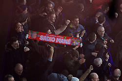 LIVERPOOL, ENGLAND - Monday, December 19, 2016: A Liverpool supporter with a Sadio Mane scarf celebrates the late injury-time winning goal against Everton during the FA Premier League match against Liverpool, the 227th Merseyside Derby, at Goodison Park. (Pic by Gavin Trafford/Propaganda)