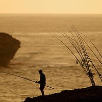 Fishermen at Laie Point, conventional shoreline surf casting