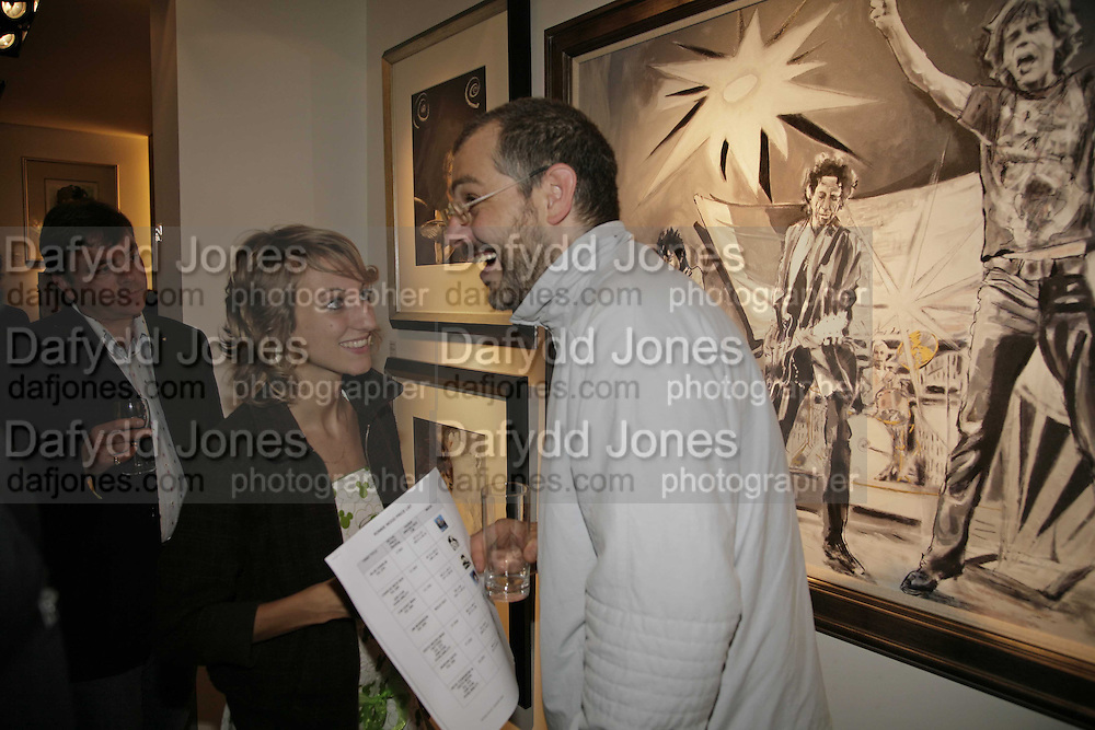 Rosalynd Brooks and John Drake, Ronnie Wood, private view. Scream, 34 Bruton Street, London, W1, 23 August 2006. ONE TIME USE ONLY - DO NOT ARCHIVE  © Copyright Photograph by Dafydd Jones 66 Stockwell Park Rd. London SW9 0DA Tel 020 7733 0108 www.dafjones.com