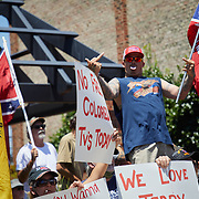 GRAHAM, NC - July 11: Supporters of the Confederacy and the Confederate monument at the Alamance County Court house yell at supporters from the Burlington-Alamance March For Justice and Community that had just marched down Harden Street to hold a rally in front of the monument in in Graham, NC on July 11, 2020.  In the previous weeks, the Alamance County Sheriff had put a stop to protests in Graham near the site of a confederate monument but was ruled unconstitutional in a federal court. The group who organized the protest seized the opportunity to apply for a permit just days after.  (Photo by Logan Cyrus for AFP)