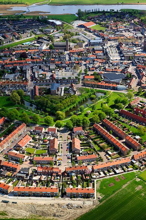 Nederland, Zeeland, Gemeente Sluis, 09-05-2013;  Oostburg, hoofdplaats van de gemeente Sluis. In de voorgrond de Kroonwijk met gereconstrueerd bastion.<br /> Oostburg is tijdens de Tweede Wereldoorlog zwaar beschadigd en vrijwel geheel herbouwd (naoorlogs wederopbouwgebied). <br /> The village of Oostburg (Zeeland) is heavily damaged during World War II and almost completely rebuilt. A reconstructed bastion in the park (m). <br /> luchtfoto (toeslag op standard tarieven);<br /> aerial photo (additional fee required);<br /> copyright foto/photo Siebe Swart.