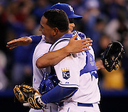 Kansas City Royals pitcher Jeremy Guthrie (11) is hugged by catcher Salvador Perez (13) at the end of a baseball game against the Chicago White Sox at Kauffman Stadium in Kansas City, Mo., Saturday, May 4, 2013. Guthrie pitched a shutout, beating the White Sox, 2-0.  (AP Photo/Colin E. Braley).