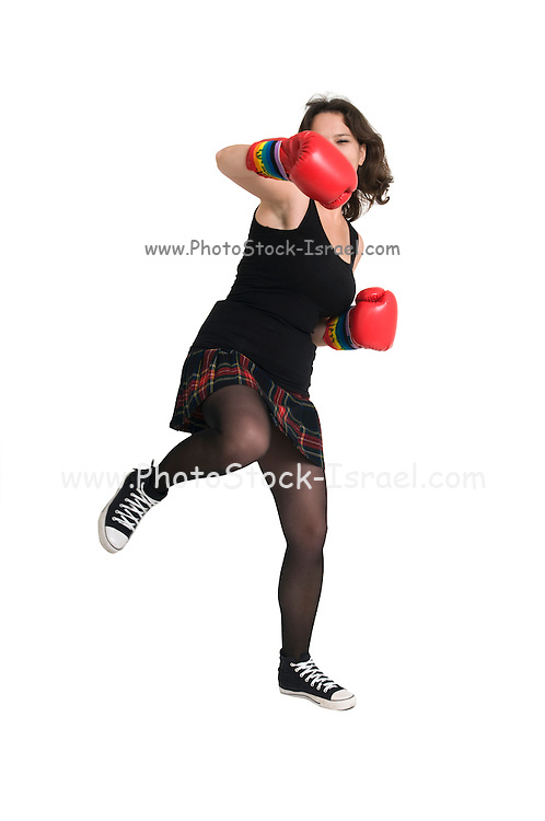young woman with boxing gloves throws a punch