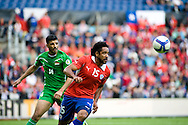 14.09.13. Brondby, Denmark.Chile's Jean Beausejour scoring the fourth goal against Irak during the international friendly match at the Brondby Stadium in Denmark.Photo: © Ricardo Ramirez