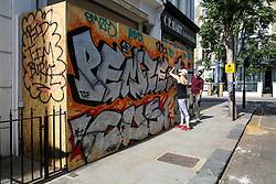 © Licensed to London News Pictures. 24/08/2019. London, UK. A business property boarded up ahead of the 2019 Notting Hill Carnival which takes place this weekend and on bank holiday Monday. Up to 1 million people are expected to attend the biggest street party in Europe. Photo credit: Dinendra Haria/LNP