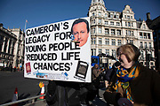 Anti Brexit protesters with a David Cameron legacy placard as Prime Ministers questions is due to start in Westminster outside Parliament on 29th January 2020 in London, England, United Kingdom. With only two days until the UK is due to leave the EU, these will be some of the last protests with the UK as a European nation.