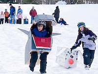 """""""Shark Bite"""" Daegan Boucher and """"Fluffy"""" Michelle Gallant compete in the Gilford Parks and Recreation cardboard box derby on Wednesday at the Gilford Outing Club as part of a week long winter celebration.  Boucher received a """"best use of cardboard"""" ribbon and Gallant a """"most creative"""" for their efforts.  (Karen Bobotas/for the Laconia Daily Sun)"""