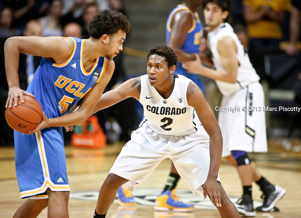 SHOT 1/13/13 1:46:26 PM - Colorado's Xavier Johnson #2 guards  UCLA's Kyle Anderson #5 during their regular season Pac-12 basketball game at the Coors Events Center on the University of Colorado campus on Saturday January 12, 2013. UCLA won the game 78-75. (Photo by Marc Piscotty / © 2013)