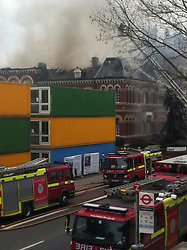 © London News Pictures. 25/03/2013 .London, UK.  Fire crews and emergency services at the scene of a .  Photo credit : Aisha Khalid /LNPa major fire which has engulfed a museum and library in south east London. 15 fire engines, with 97 firefighters, were at the scene of the blaze ripped through a building on Walworth Road, Walworth. Photo credit: Aisha Khalid/LNP