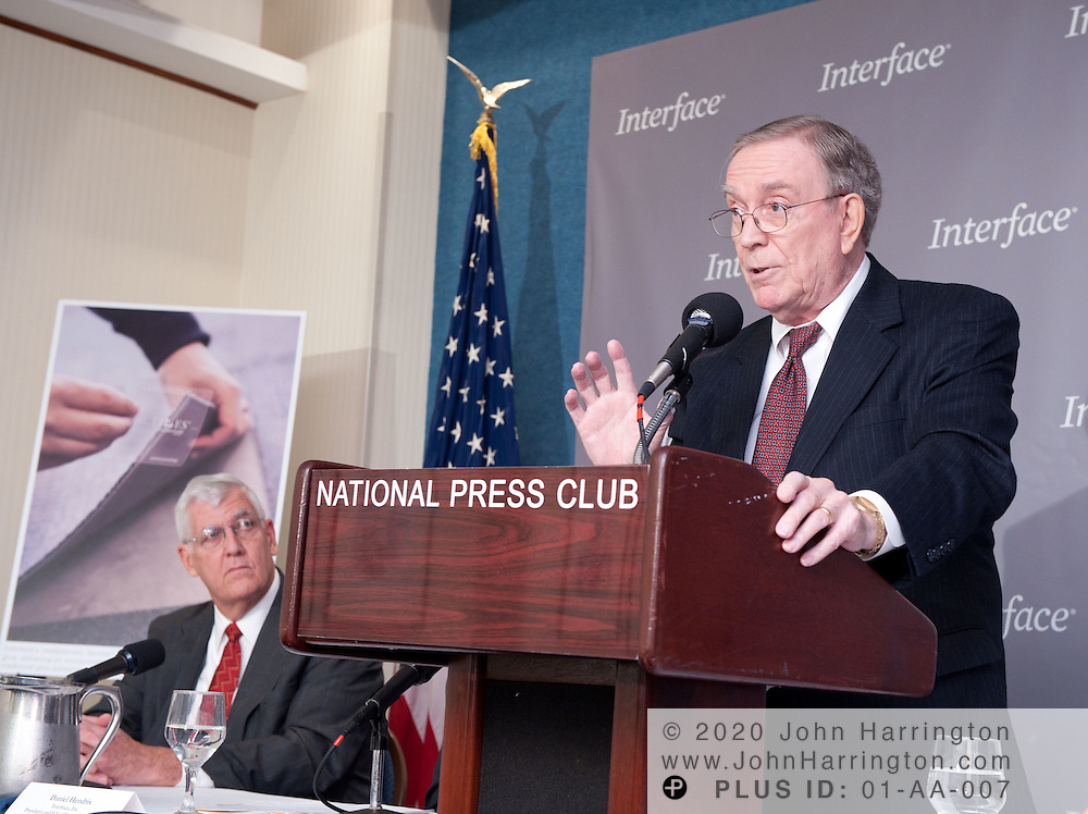 """Ray Anderson (right), chairman and founder of Interface, Inc. speaks at a press conference on the occasion of the company passing the halfway mark in its journey to """"Mission Zero"""" - sustainability by 2020, Tuesday, November 9, 2010 at the National Press Club, as Alan Anderson (left), Director of the Concept Center and Chief Engineer of Payload Systems for Boeing Commercial Airplanes, looks on.  Interface announced it will offer third-party environmental product declarations on its carpet products worldwide by 2012, and Boeing is currently testing Interface products in its aircraft.."""