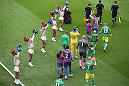 Both sets of players enter the field of play for the start of the match as the 'Crystals' Cheerleaders perform. Barclays Premier League match, Crystal Palace v Norwich city at Selhurst Park in London on Saturday 9th April 2016. pic by John Patrick Fletcher, Andrew Orchard sports photography.
