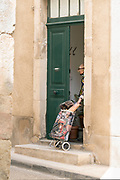 elderly woman coming home from food shopping during the Covid 19 crisis and lockdown France Limoux May 2020