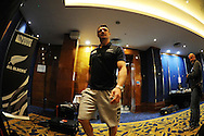 Dan Carter of New Zealand walks into the room. Rugby World Cup 2015 , New Zealand Allblacks player media session at the Hilton Hotel in Cardiff , South Wales on Monday 28th September 2015. The Allblacks are in Cardiff preparing for their next pool match against Georgia on Friday night.<br /> pic by  Andrew Orchard, Andrew Orchard sports photography.