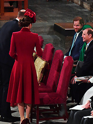 The Duke of Sussex (smiles) towards the Duke and Duchess of Cambridge (left) as he sits with his wife and the Earl and Countess of Wessex, during the Commonwealth Service at Westminster Abbey, London on Commonwealth Day. The service is the Duke and Duchess of Sussex's final official engagement before they quit royal life.