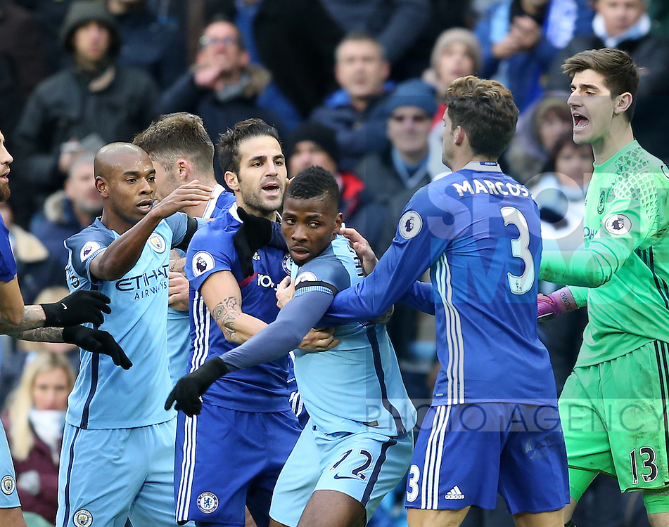 Fernandinho of Manchester City prepares to grab Cesc Fabregas of Chelsea who is grabbing Kelechi Iheanacho of Manchester City during the Premier League match at the Etihad Stadium, Manchester. Picture date: December 3rd, 2016. Pic Simon Bellis/Sportimage