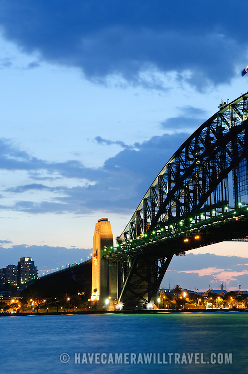 Dusk view of the Sydney Harbour Bridge looking back towards the historic Rocks district and Dawes Point