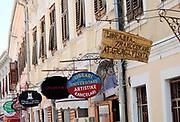 Shop signs in the centre of Shkoder. Shkodër, Albania. 02Sep15