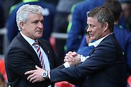 Stoke manager Mark Hughes greets Cardiff manager Ole Gunnar Solskjaer. Barclays Premier league match, Cardiff city  v Stoke city at the Cardiff city stadium in Cardiff, South Wales on Saturday 19th April 2014. pic by Mark Hawkins, Andrew Orchard sports photography,