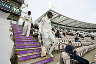 James Vince of Hampshire and Joe Weatherley of Hampshire walk out to bat during the first day of the Specsavers County Champ Div 1 match between Hampshire County Cricket Club and Essex County Cricket Club at the Ageas Bowl, Southampton, United Kingdom on 5 April 2019.