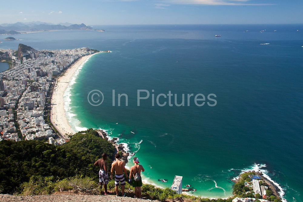 The Dois Irmaos two brothers trail is fast becoming the most popular hike in Rio de Janeiro. Located in the South Zone of the city, in the pacified Vidigal favela, it rewards fantastic views over the city, beaches and mountains. Since pacification in 2011, Vidigal has slowly become known as what some call a model favela, seen as the safest favela in Rio, home to a mixed community which now includes foreigners, hostels, restaurants, theatres and creative businesses.