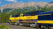 Alaska; Mountain scenic of the Alaska Railroad leaving the Denali Park Station northbound, Denali National Park.