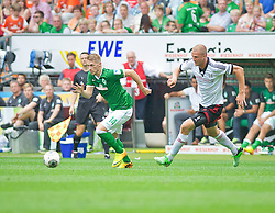 "28.07.2013, Weserstadion, Bremen, GER, 1.FBL, ""Tag der Fans 2013"" des SV Werder Bremen, Testspiel SV Werder Bremen vs Fulham FC, im Bild Aaron Hunt (Bremen #14) am Ball, verfolgt von Brede Hageland (Fulham FC #5) // during the ""Tag der Fans 2013"" of the German Bundesliga Club SV Werder Bremen at the Weserstadion, Bremen, Germany on 2013/07/28. EXPA Pictures © 2013, PhotoCredit EXPA Andreas Gumz ***** ATTENTION - OUT OF GER *****"
