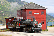 This historic steam engine number 73 gets water in Fraser, British Columbia Canada as part of the White Pass and Yukon Route railroad from Skagway, Alaska.