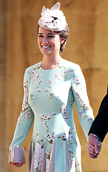 Pippa Middleton arrives at St George's Chapel in Windsor Castle for the wedding of Prince Harry and Meghan Markle.